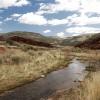 Sand Creek winds through red rock canyons